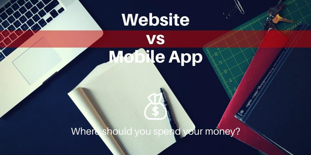 Website vs Mobile App: Where should you spend your money? Laptop sitting on a table with graph paper also.