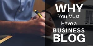 Why you must have a business blog over man writing on notepad